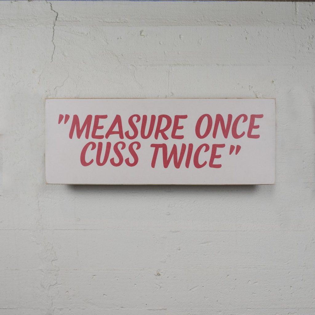 """measure once, cuss twice"" sign from  laurelmerchantile.com"