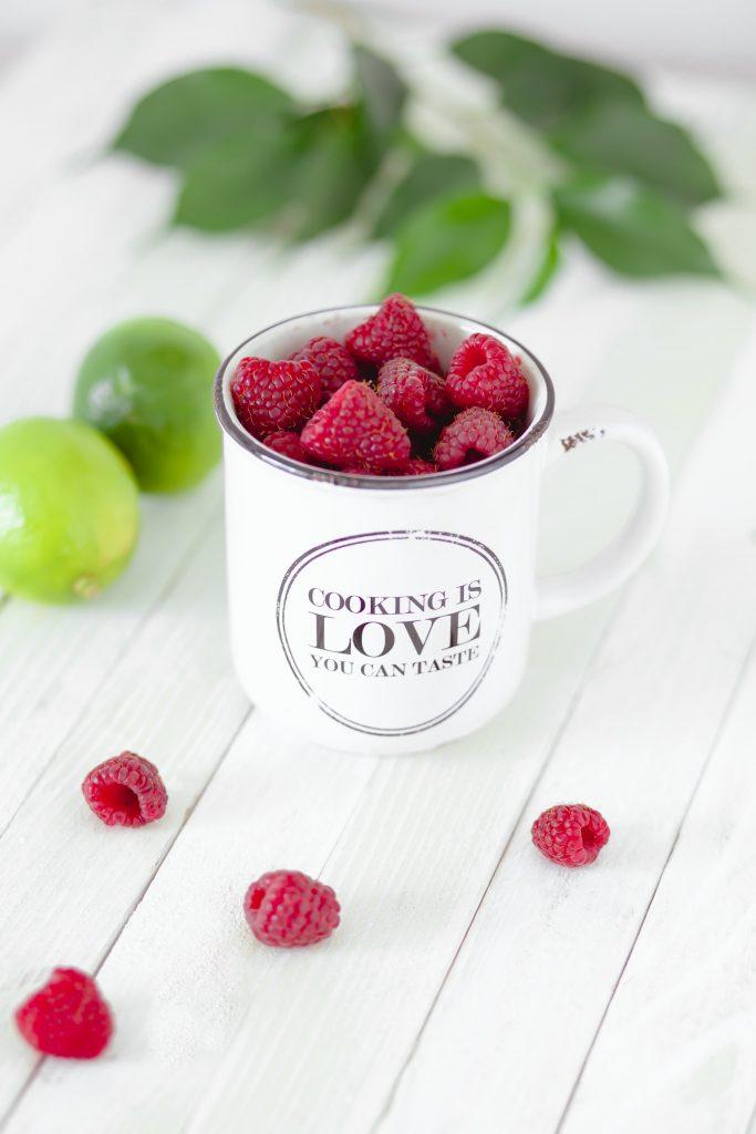 raspberries in a retro mug