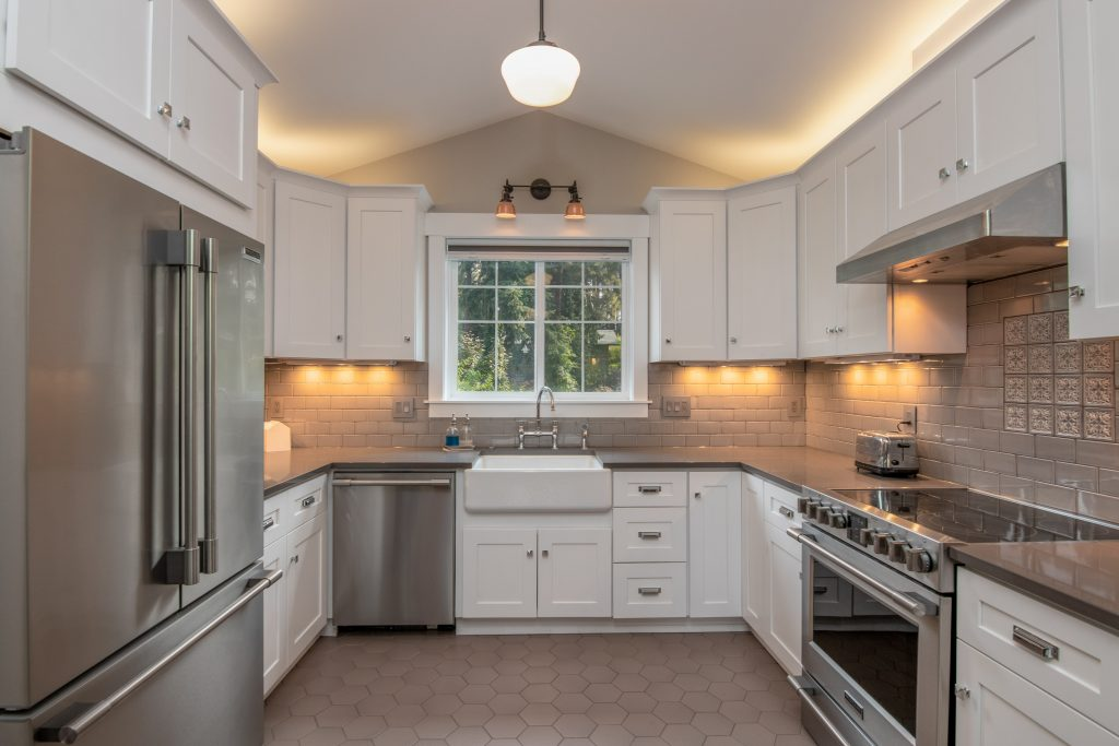 shaped kitchen with white cabinets
