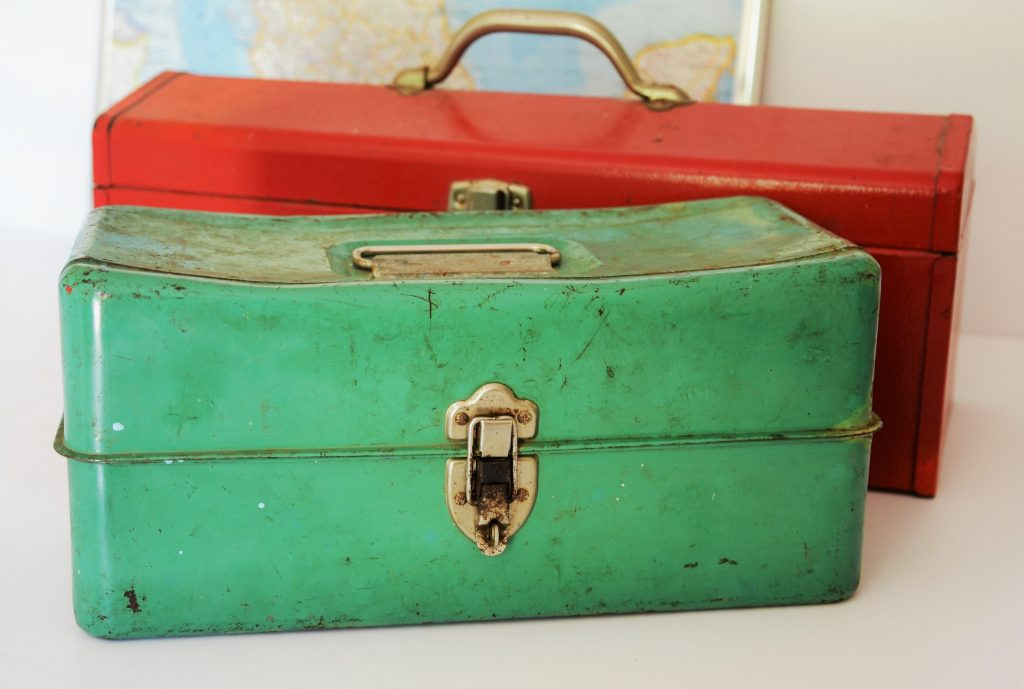 two beauty tool boxes one red and one green